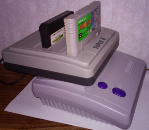 The Famicom and NES portions are handled by a system on a chip, but I haven't found any incompatibility issued yet. Yes, it even plays Castlevania 3 without ...